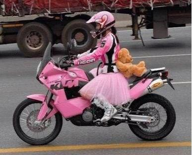 woman in pink on motorcycle